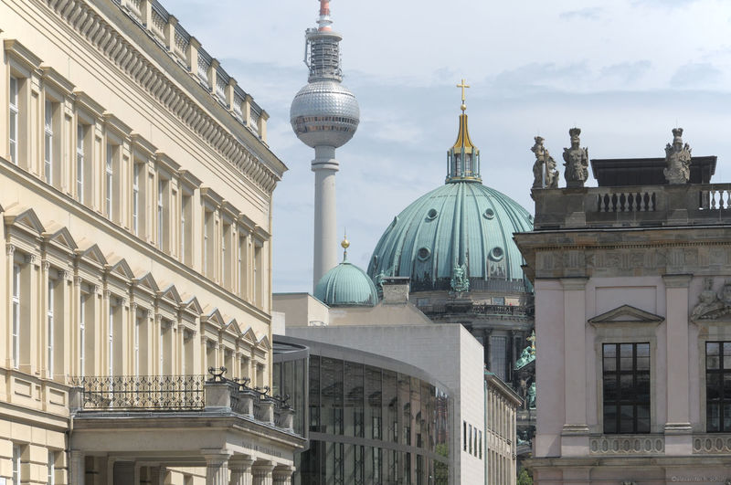 Fernsehturm and berlin cathedral amidst buildings