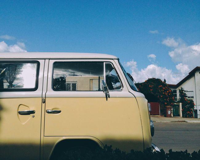 Van parked on street against blue sky