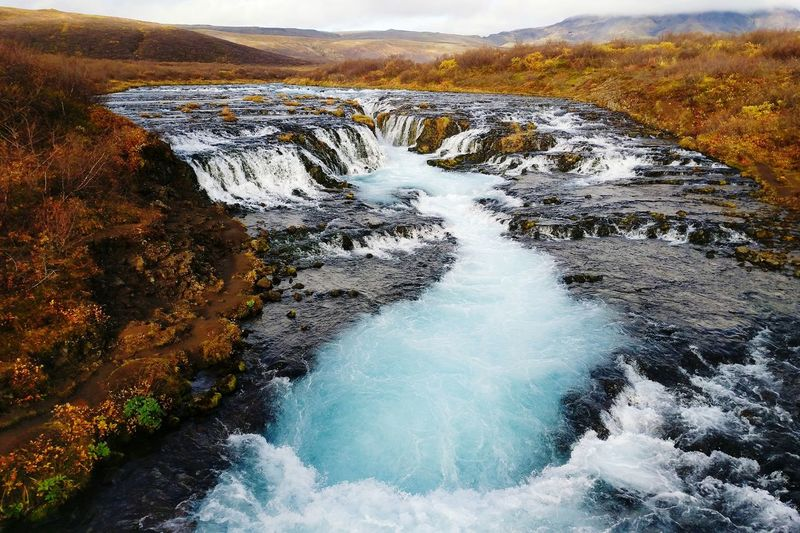 Beauty In Nature Landscape Bruarfoss Bruarfoss Waterfall Iceland Golden Circle Fall Autumn Fall Colors Travel Destinations Travel In Iceland Waterfall Blue Water Water Power In Nature Wave Volcanic Landscape Motion Flowing Water Stream Stream - Flowing Water