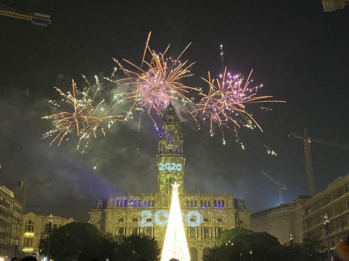 Firework display in sky at night