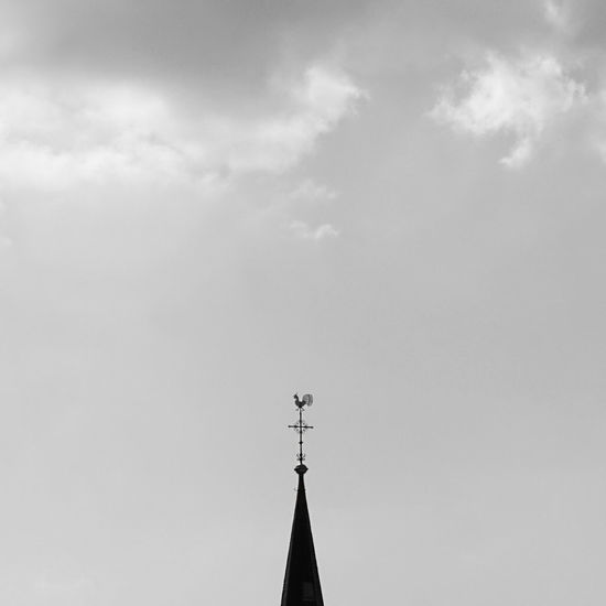 Weather Vane On High Section Against Sky
