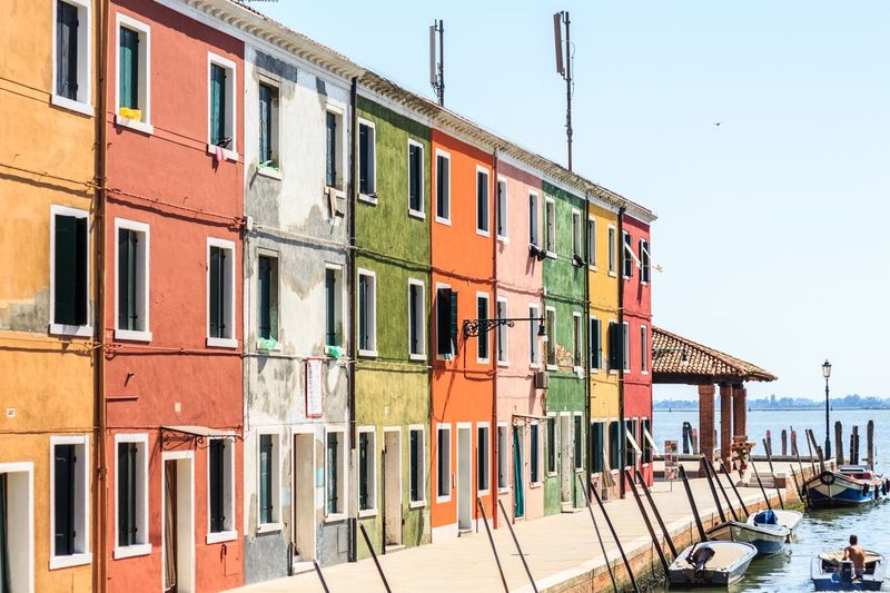 Colorful houses on the island of Burano near Venice, Italy Italy Color Yellow Green Red Venice, Italy Burano Houses Coloful Building Exterior Built Structure Architecture Sky Building Clear Sky Window Residential District In A Row Multi Colored Canal EyeEmNewHere