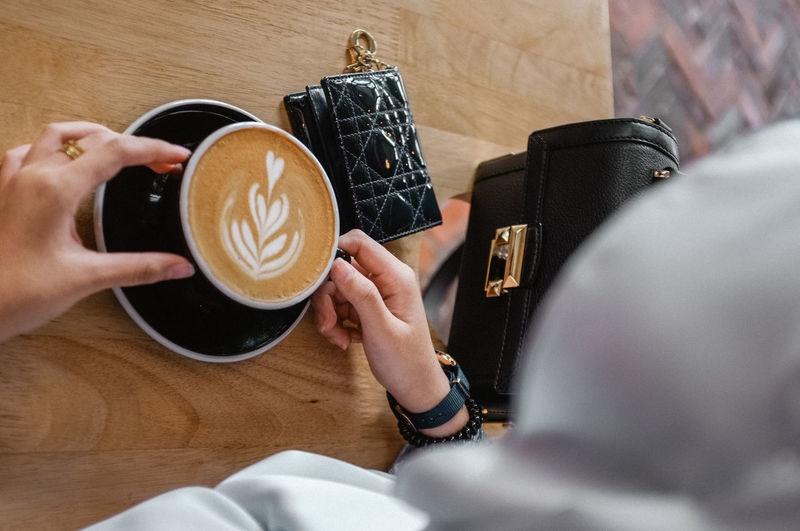 High angle view of woman coffee cup