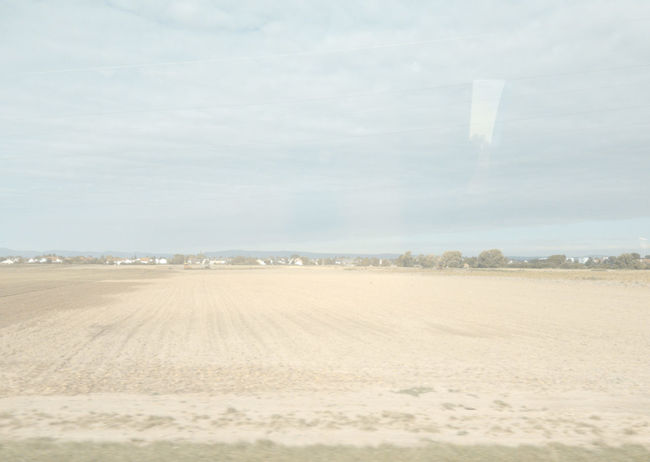 #16154 Agriculture Environment Field Land Landscape Nature Non-urban Scene PhonePhotography Rural Scene Scenics - Nature Sky Tranquil Scene Tranquility View From Train Window View From Train,