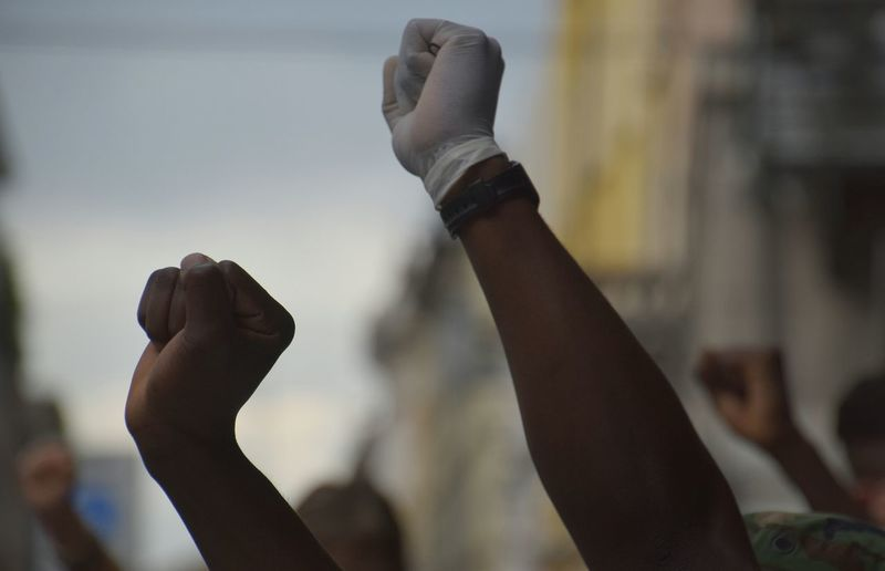 People with arms raised during protest