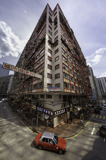 My Best Photo Apartment Office Building Exterior Outdoors No People Symbol City Street Sign Nature Day Building Street Land Vehicle Cloud - Sky Road Motor Vehicle Car Sky City Transportation Mode Of Transportation Building Exterior Built Structure EyeEm Selects EyeEm Gallery EyeEm Best Shots Hong Kong Wideangle Quarry Bay Architecture Taxi North Point Hong Kong North Point