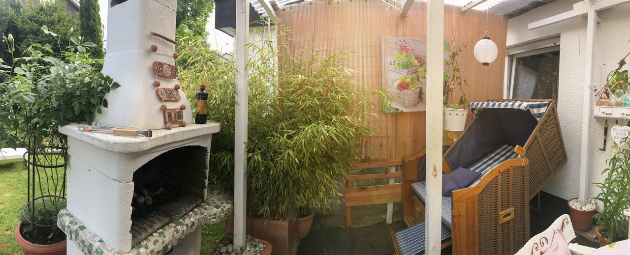 Panorama from a reconsidered terrace Home Terrace Architecture Bamboo Basket Chair Building Exterior Chair Covered Day Fireplace FreeTime Garden Garden Stove Growth Huge Grill Interior Lens Flares No People Outdoors Plant Potted Plant Reconsidered Roofed Roses Summer Summer Exploratorium