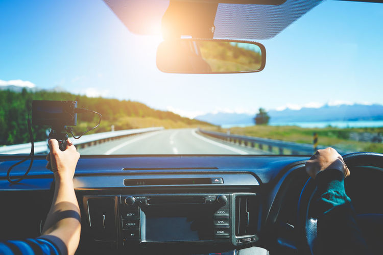 Travelers recording video vlog, stunning landscapes view on a road trip. travel vlogger concept.