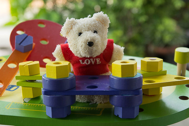 Come play with me Animal Animal Representation Animal Themes Close-up Day Mammal Multi Colored Representation Stuffed Toy Teddy Bear Text Toy Toy Block Western Script