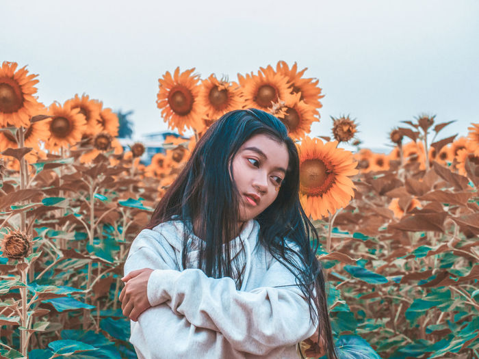 why i always look for the sun. One Person Young Adult Young Women Leisure Activity Portrait Standing Front View Looking At Camera Real People Waist Up Lifestyles Land Long Hair Hairstyle Women Field Hair Smiling Beautiful Woman Outdoors Warm Clothing Teenager Sunflower Vibrant Color Girl