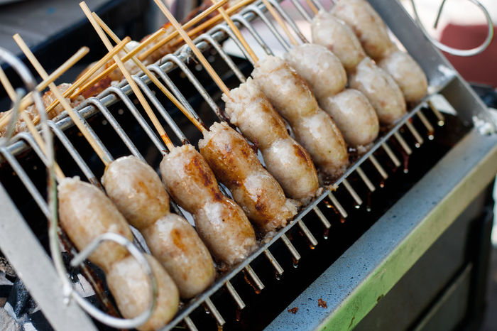 Thai Sausage on the stove, Thailand street food. Meal Skewer Stove Thai Sausage Barbecue Barbecue Grill Close-up Food Food And Drink Freshness Grill Grilled Heat - Temperature No People Preparation  Ready-to-eat Roast Street Food Thai Food Thai Style Wood Stick