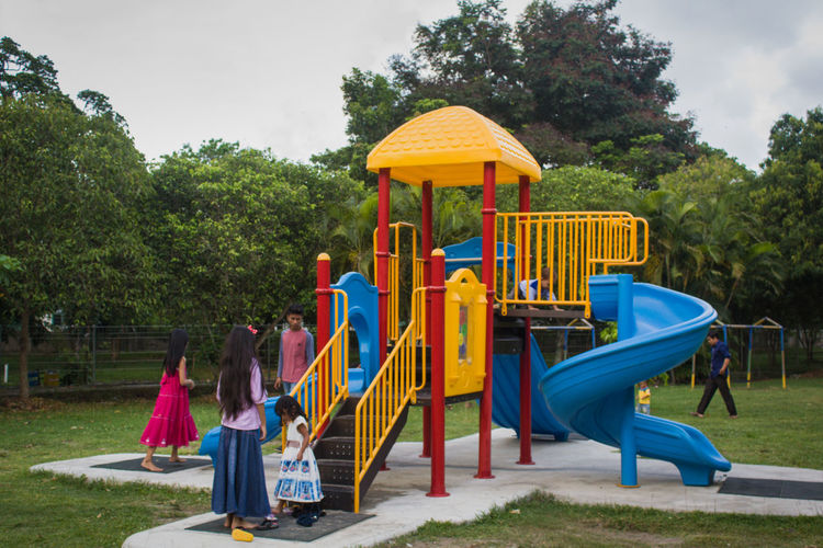 Paint The Town Yellow Playground Childhood Child Outdoor Play Equipment Girls Sand Jungle Gym Tree Children Only Full Length Elementary Age Boys People Swing Fun Playing Summer Park - Man Made Space Multi Colored Outdoors