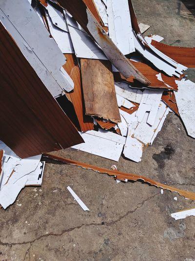 High angle view of broken on wooden floor