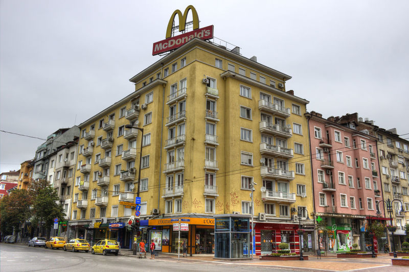 Architecture Building Exterior Built Structure City City Life City Street Cloud Day Exterior Mcdonalds No People Office Building Outdoors Sky Street Tall - High Window