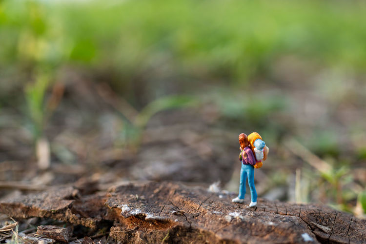 Miniature people backpackers walking with friends