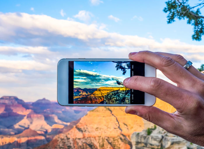 Cropped Image Of Person Photographing Grand Canyon National Park With Smart Phone