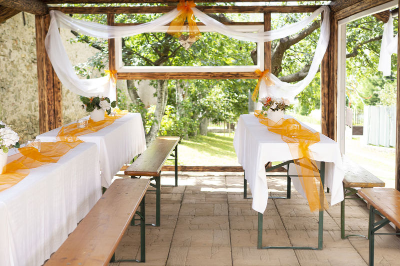 Empty chairs and table in porch