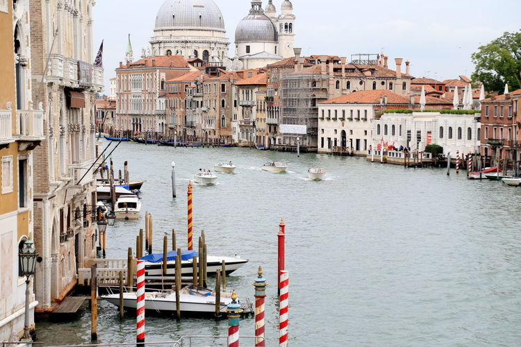 Boats sailing in grand canal against santa maria della salute