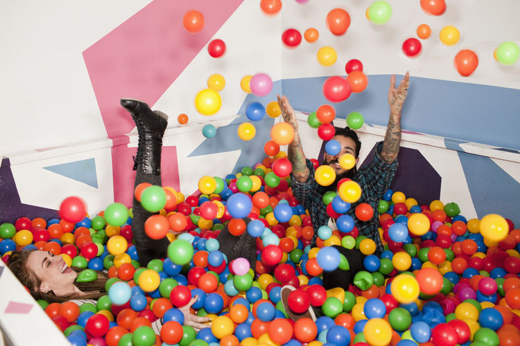 High angle view of person holding multi colored balls