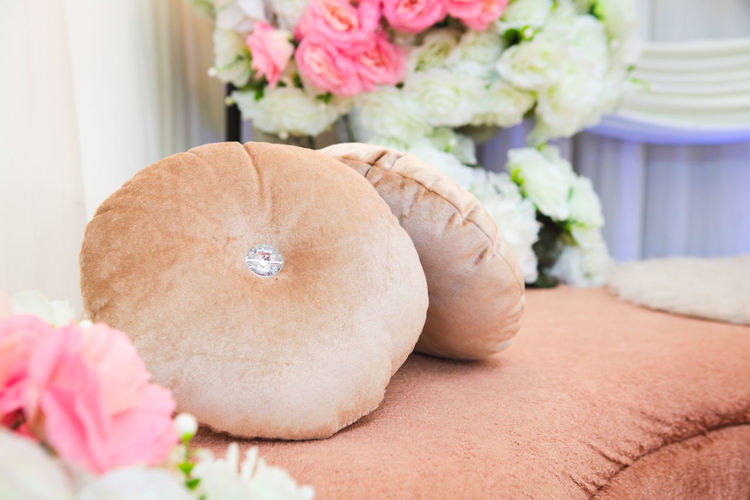 Close-Up Of Sofa Amidst Bouquet During Wedding