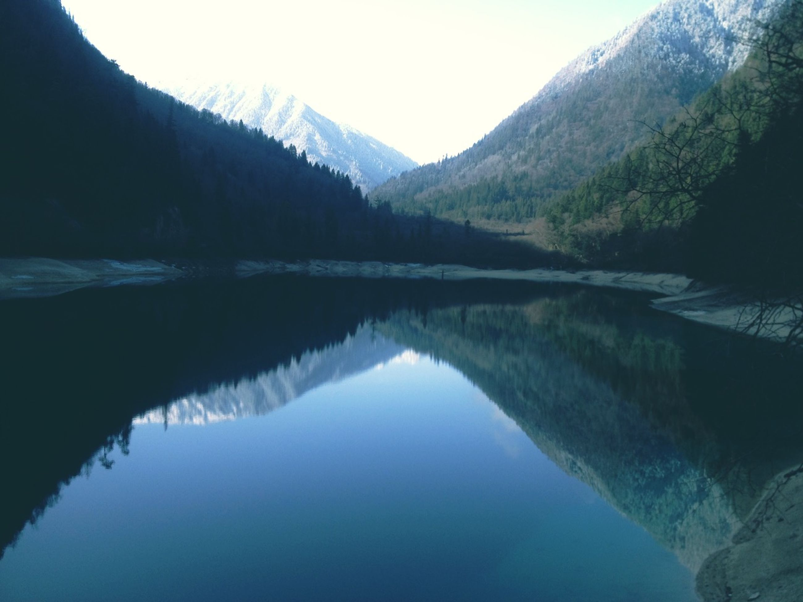 mountain, water, reflection, lake, tranquility, tranquil scene, scenics, mountain range, beauty in nature, waterfront, nature, standing water, tree, river, clear sky, idyllic, calm, non-urban scene, sky, landscape