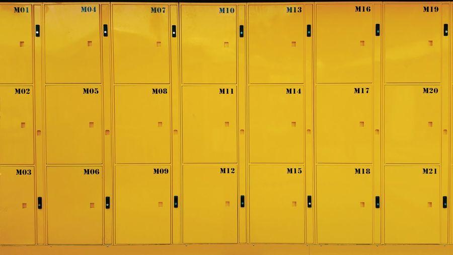 Full Frame Shot Of Closed Yellow Lockers