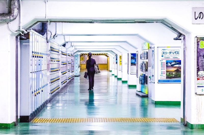 Tokyo Tokyo Travel Destinations Full Length Indoors  Corridor Walking One Person The Way Forward The Graphic City Real People Architecture Adult Day People Men Mobility In Mega Cities EyeEmNewHere Modern Workplace Culture The Street Photographer - 2018 EyeEm Awards Streetwise Photography