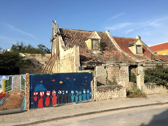 Historic Pietermaai district in Willemstad, Curaçao, to be restaurated Architecture Building Exterior Built Structure Curacao Day Derelict Building Graffiti Monument Multi Colored Nature No People Outdoors Pietermaai Pietermaai District Restauration Project Sky Sunlight Tree Willemstad