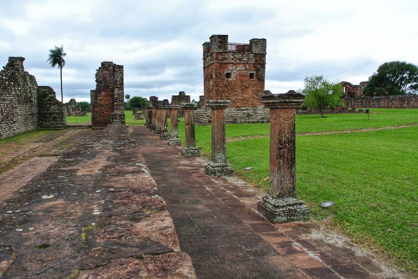 UNESCO World Heritage. Trinidad, Paraguay. Trinidad Santisima Trinidad Paraguay Encarnacion Jesuit Mission Church Christianity World Heritage UNESCO World Heritage Site Architectural Detail Ruins Architecture Stone Nature Old Ruin Ancient Civilization History Castle Sky Architecture Building Exterior Grass Cloud - Sky Fort Lookout Tower Stone Wall Fortress Archway Surrounding Wall Past Entryway