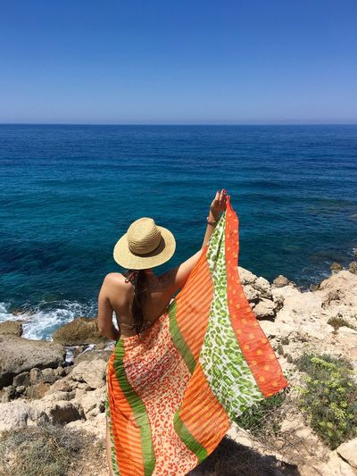 Cyprus Summertime Back View Of Girl Beach Beauty In Nature Hat Horizon Over Water Leisure Activity Lifestyles Nature One Person Outdoors Pafos Scenics Sea Shore Summer Sun Hat Sunhat Tranquility Vacations Water Wind Women Young Women