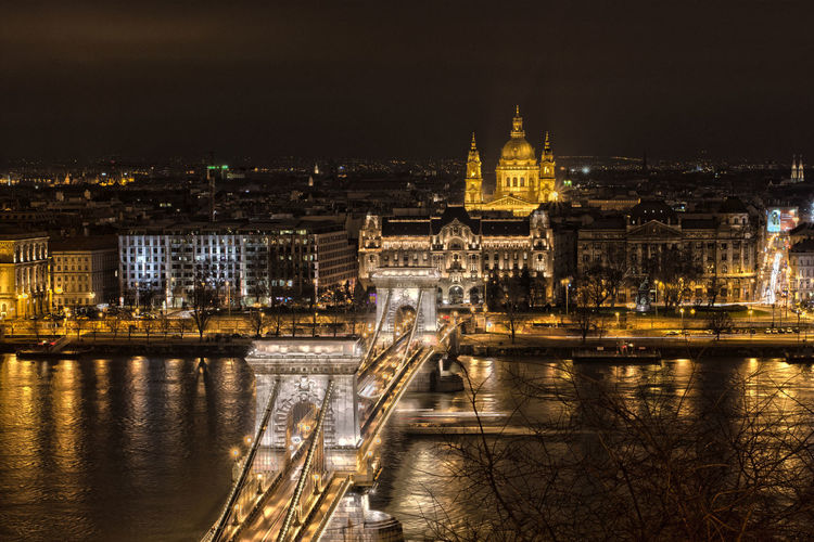 Illuminated szechenyi chain bridge over danube river at night