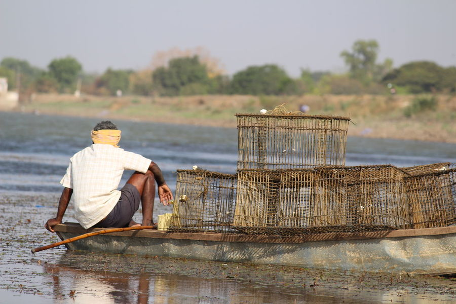 """""""While on a road trip, the worry of fishermen on account of low rainfall reflected through their face and became the shot of my shutter""""Fisherman Fishing Lifestyles Outdoors People Of The Oceans Worried Noedit Nofilter Noedit Feel The Journey Canon Canonphotography Canon700D Canon700dphotography Canon700dshots"""