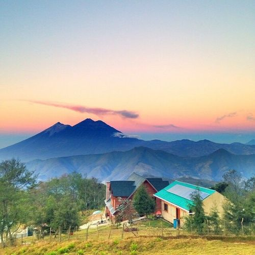 Scenic view of village against sky during sunset