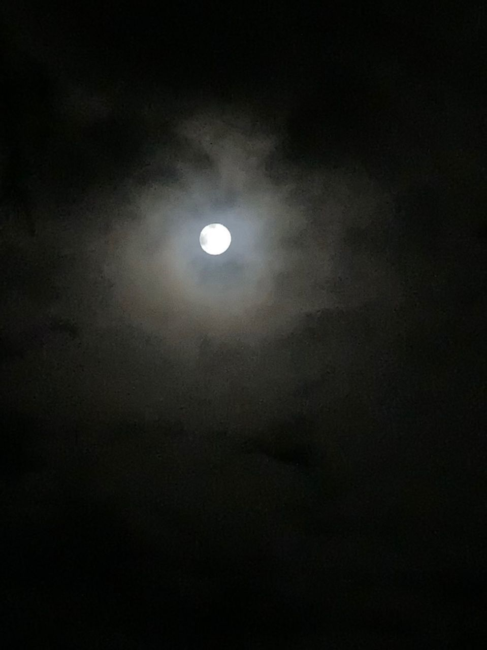 LOW ANGLE VIEW OF MOON IN THE DARK SKY