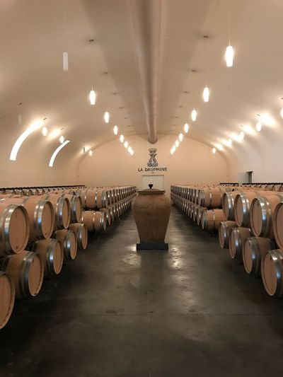 Châteu la dauphine Wine Testing Wine EyeEm Selects In A Row Illuminated Lighting Equipment Large Group Of Objects Indoors  Ceiling Arrangement Wine Cellar No People Barrel Wine Cask