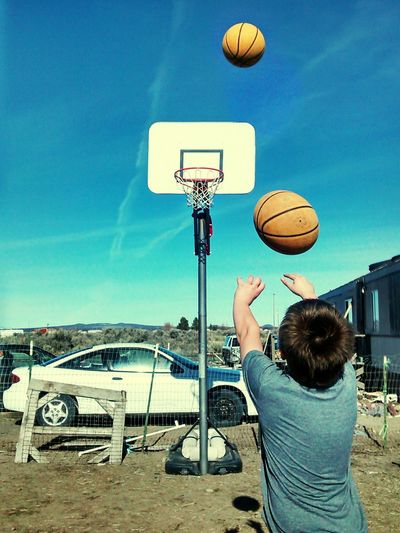 Coolpic alert! Taking Photos on my phone, and somehow it captured the ball in motion like this.. Basketball Shooting Hoops Check This Out Awesome_shots Sunny Day Kids Having Fun NiceShot CaptureTheMoment People My Kids Badass! Basketball ❤ Nothingbutnet Swoosh! Motion Capture Sport Amazing Gettyimages Getty X EyeEm Getty Gettyimagesgallery Capturing Movement