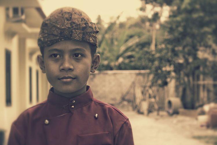 Portrait of boy wearing hat at park