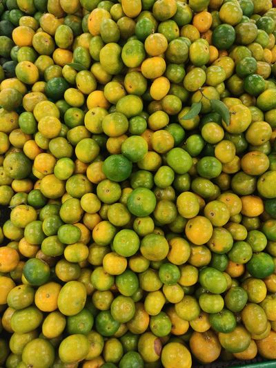 Orange fruits with different colours ready for sale