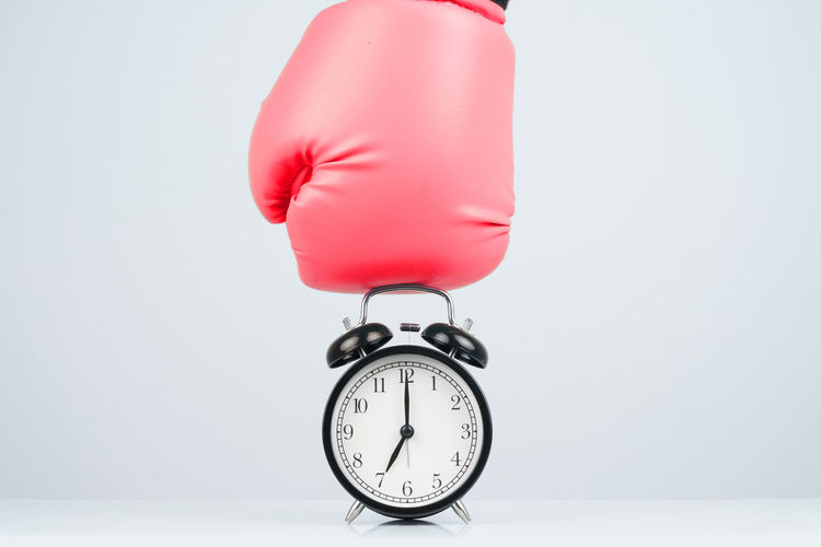 Black retro alarm clock on white background. Active Against Alarm Angry Awaken Beat Box Boxer Boxing Break Business Call Challenge Classic Clock Countdown Deadline Destroy Encouragement Fight Gloves Gym Hand Hour Minute Morning Motivation Over Panic Part Period Power Punch Red Retro Second Smash  Sport Sportswear Stop Strength Time Timer Training View Vintage Wake Watch Workout