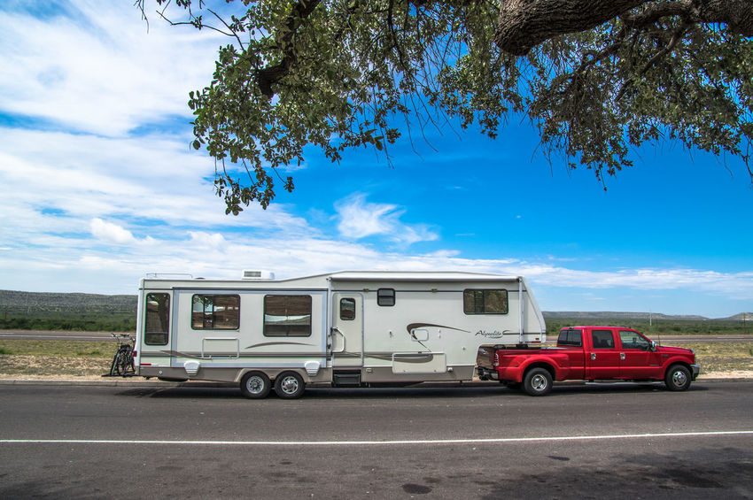 RVing Rv RVing in the USA Fifth Wheel traveling Yvon Bourque Road Trip Red Red Truck