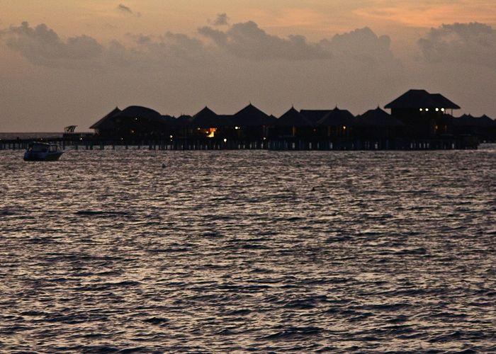 Amazing Architecture Beauty In Nature Coastline Enjoying Life Idyllic Illuminated Maldives Night Nightphotography Ocean Original Experiences Relaxing Scenics Sea Showcase June Sundown Sunset Taking Photos The Purist (no Edit, No Filter) Tranquil Scene Travel Waterfront Watervillage Wineandmore