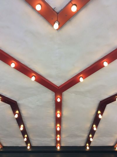 Austin Texas theatre entrance Light Bulbs Wooden Slats With Electrical Light Fittings white painted ceiling Red Painted Wood USA