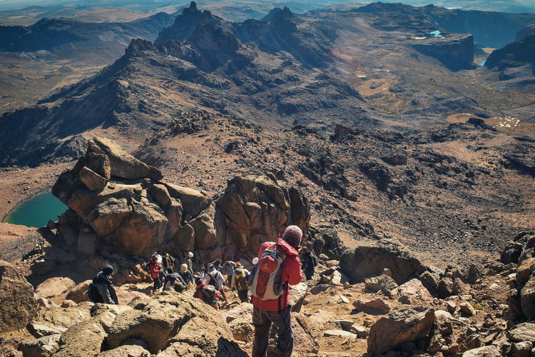 A group of hikers in the panoramic volcanic mountain landscapes of mount kenya, kenya