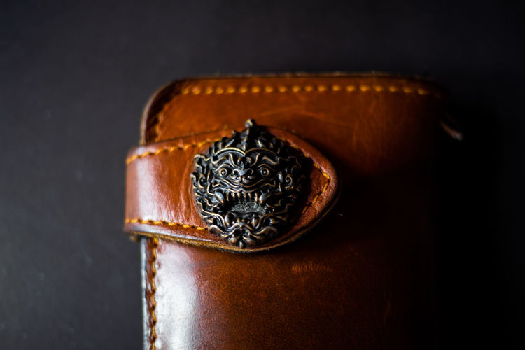Close-up of wallet against black background