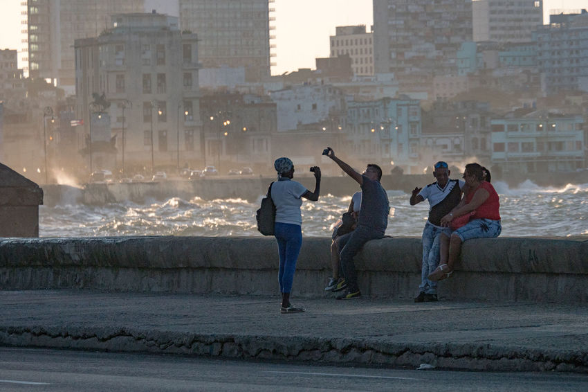 Malecon, November 2016 Before Sunset Coastline Photographing The Photographer Adult Adults Only Architecture Building Exterior Built Structure City Cityscape Day Evening Full Length Malecón, La Habana Men Motion Outdoors People Sea Splashing Waves Togetherness