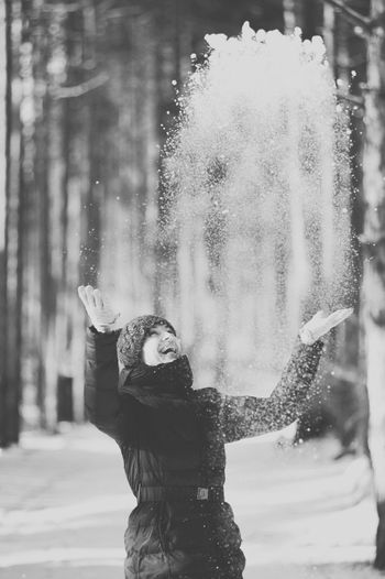 Winter luck. Girl throwing snow in the air. Beautiful Women In The World Black Black_white Blackandwhite Cold Temperature Crystal Flakes Fun Happiness Leisure Activity Lifestyles Luck Motion Nature One Person Outdoors Real People Smile_winter Snow Throwing Snow Water White Winter Winter_smile Young Women
