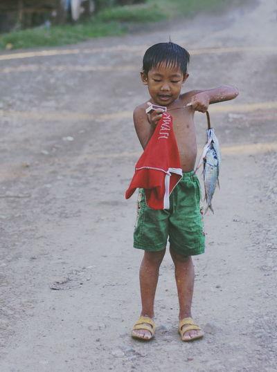Full length of boy standing outdoors