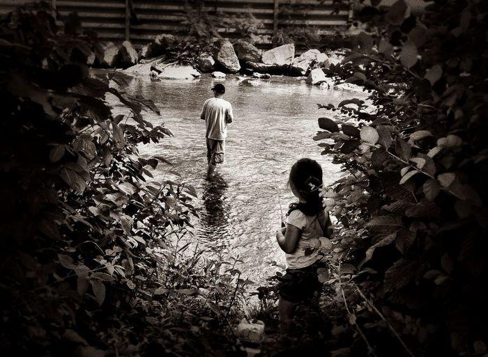 Full length of boy standing in pond