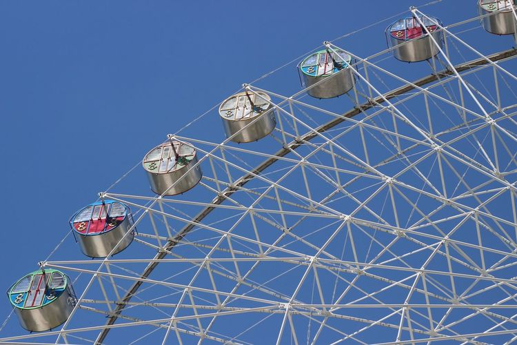 Sky Ferris Wheel Low Angle View Amusement Park Ride Amusement Park No People Clear Sky Nature Leisure Activity Built Structure Metal Arts Culture And Entertainment Architecture Outdoors Day Enjoyment Fun Blue Tall - High Large