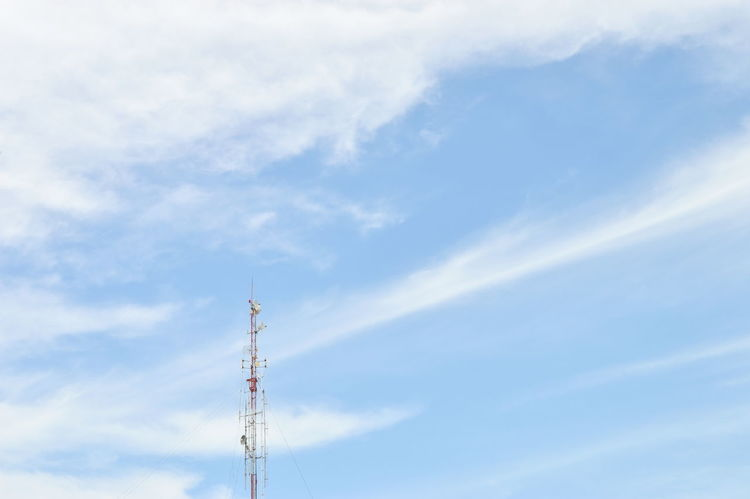 radio pole (telecommunication antenna) on blue sky and soft clouds background Blue Broadcasting Tower Cellular Cloud Communication No People Outdoors Pole Radio Sky Telecommunication Tower